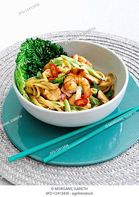 Pasta with salmon, shrimp, ginger and garlic (Asia)