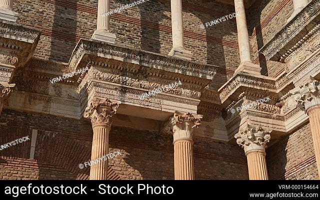Pan across the corinthian columns of the Bath Gymnasium complex of Sardis archaeological site, Hermus valley, Turkey