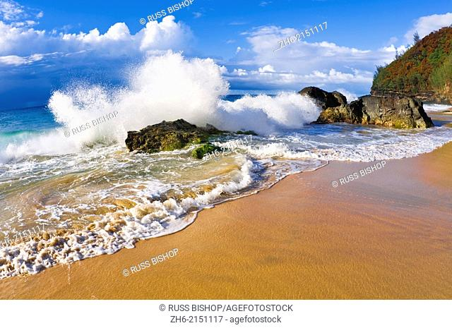 Crashing waves and rocks at Hanakapi'ai Beach, Na Pali Coast, Island of Kauai, Hawaii USA