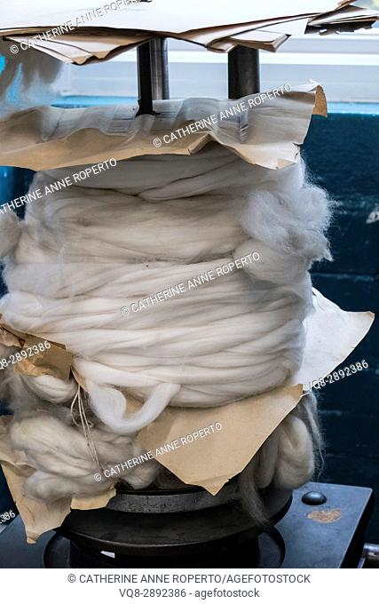 Gigantic metal spool of soft fuzzy wool with brown paper packaging, Bradford, England, UK