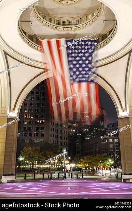 Boston, Massachusetts, USA A large American flag hangs in the rotunda at the harborwalk