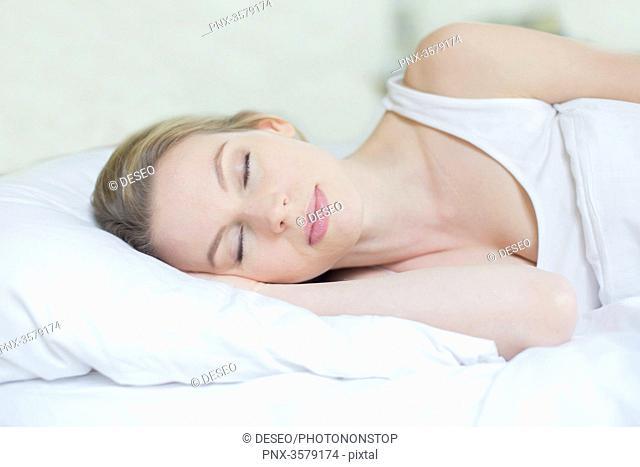 Portrait of a beautiful woman sleeping in bed