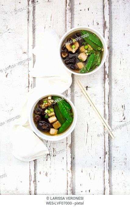 Japanese miso soup, sugar peas, shitake, tofu and mung sprouts