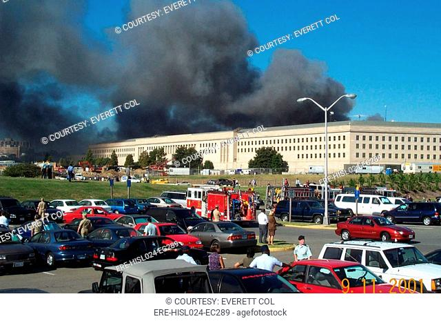 The parking lot on the Metro Concourse side of the Pentagon as smoke and flames rise from the other side of the building after it was struck by hijacked...