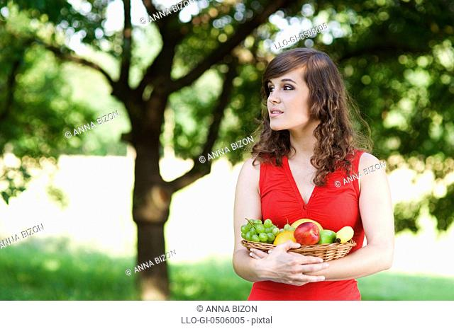 Young woman in orchard, Debica, Poland