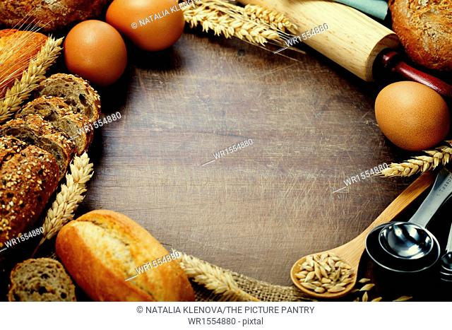 Bread and ingredients frame on wooden table