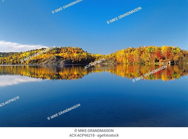 Reflection in Simon Lake. Simon Lake Park Conservation Area. Naughton Ontario Canada
