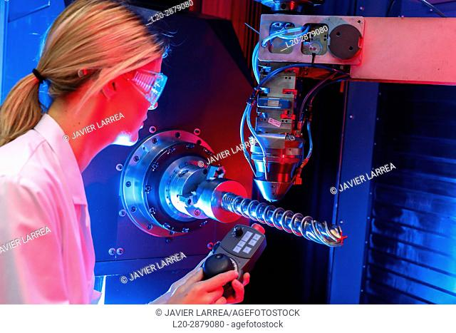 Hybrid laser machine tool for additive manufacturing. Researcher working on 3D printing machine for the industry, it allows to create large metal parts from...