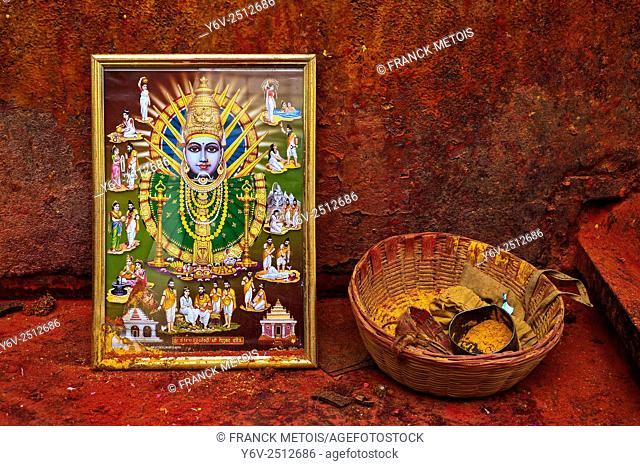 Image representing the Yellamma goddess + basket containing turmeric powder. The followers of Yellamma decorate their forehead by smearing turmeric powder