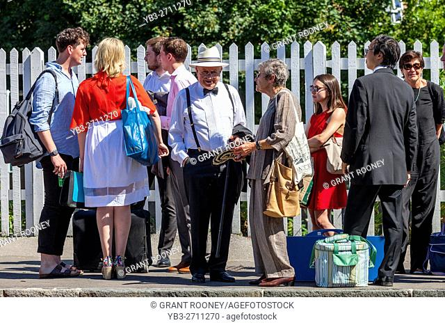 Opera Fans Wait At Lewes Station For The Shuttle Bus To Take Them To The Nearby Glyndebourne Opera House, Lewes, Sussex, UK