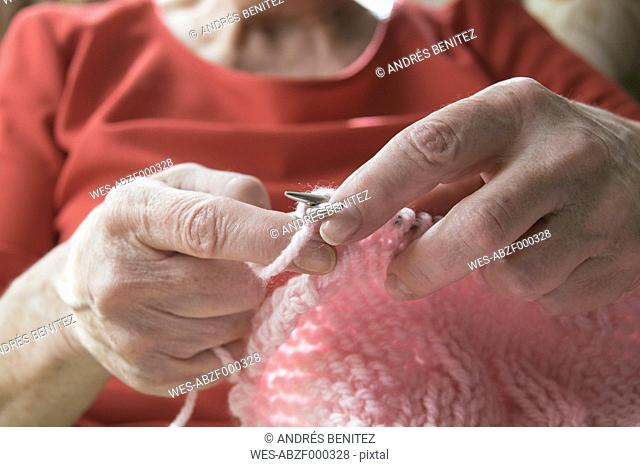 Hands of woman knitting, close-up