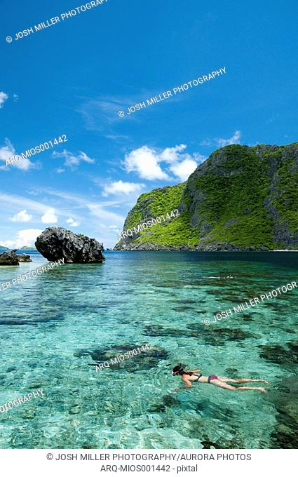 View Of Snorkeler Exploring The Tropical Reefs Of El Nido In The Philippines