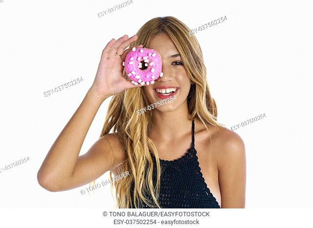 Teen girl holding donuts on her eyes as goggles at white background