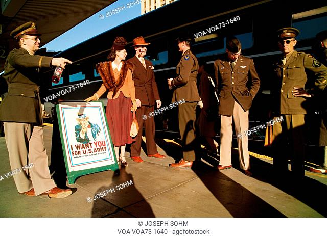 1940's reenactors stand in front of Pearl Harbor Day Troop train reenactment from Los Angeles Union Station to San Diego
