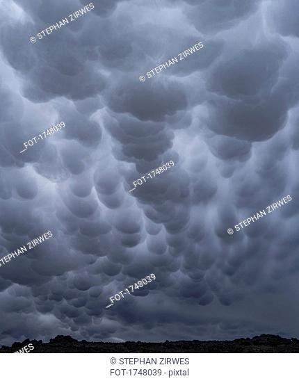 Low angle view of mammatus clouds in sky, Iceland