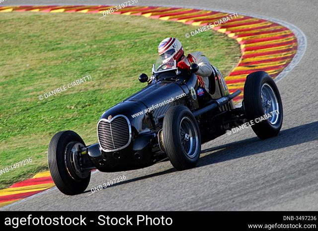 MUGELLO, ITALY - 2007: Unknown run with Vintage Maserati Grand Prix Cars on Mugello Circuit at the Event of Ferrari Racing Days Year 2007, Italy