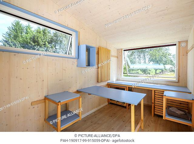 """25 June 2019, Saxony, Lichtenau: View into the caravan """"""""Friedel"""""""", called Tiny House, with ingenious furniture concept on a camping site in the Lichtenau..."""