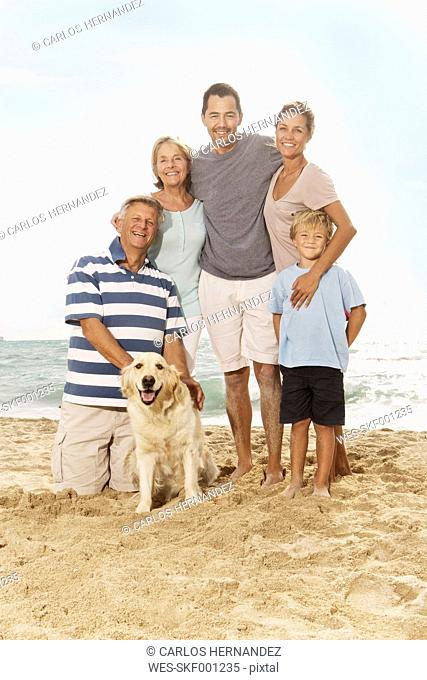 Spain, Portrait of family on beach at Palma de Mallorca, smiling