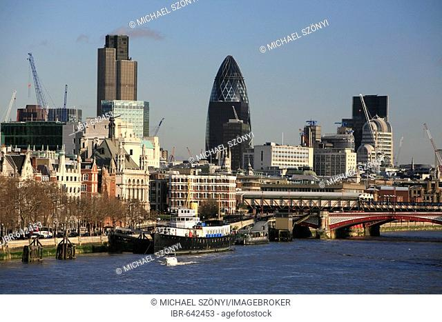 View from a bridge over the Thames toward City of London including Swiss Re Tower, London, England, UK, Europe