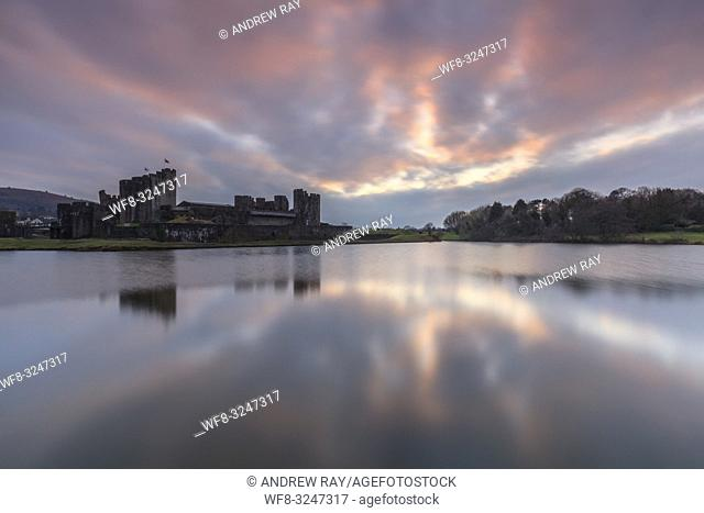 Sunset over Caerphilly Castle in South Wales, captured on an evening in mid February. A long shutter speed was utilised to flatten ripples on the surface of the...