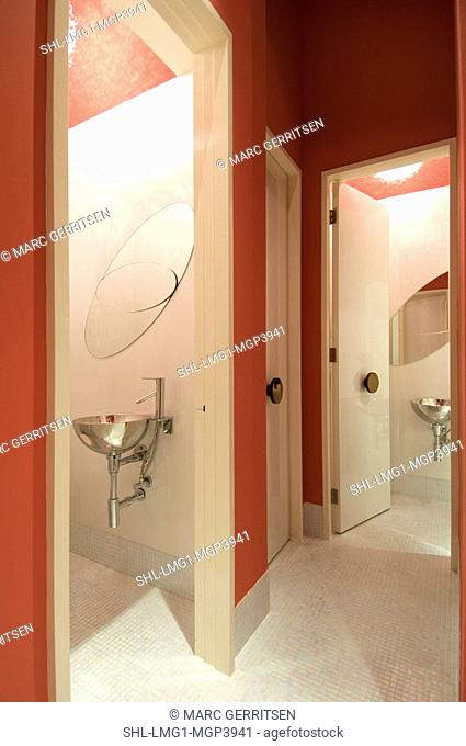 Red and white bathroom with mosaic tile floor