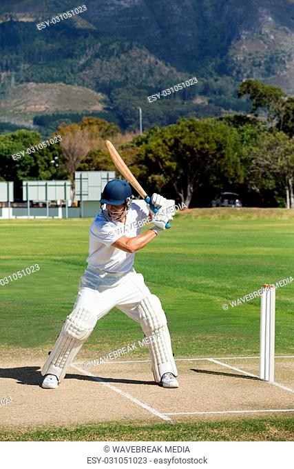 Cricket player practicing on field