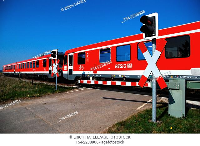 Train passes through a closed level crossing
