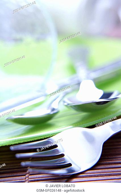 Fork and spoons green background