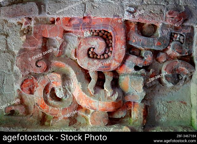 A close-up secion of the colorful stucco frieze inside the Sructure I temple in the ancient Mayan city of Balamku, Mexico