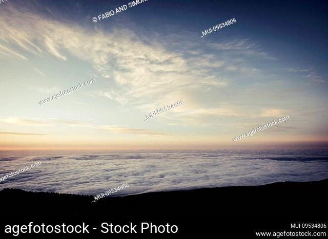 Sky and clouds beautiful rare landscape - blue colors and horizon - beauty of outdoor nature - fly and travel concept - sunset or sunrise time and