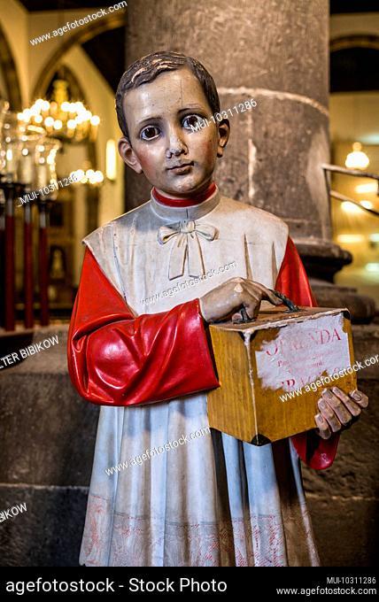 Spain, Canary Islands, Tenerife Island, Garachico, Iglesia de Santa Ana church, altar boy statue donation box