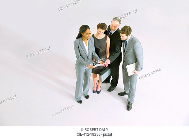 Business people reviewing paperwork