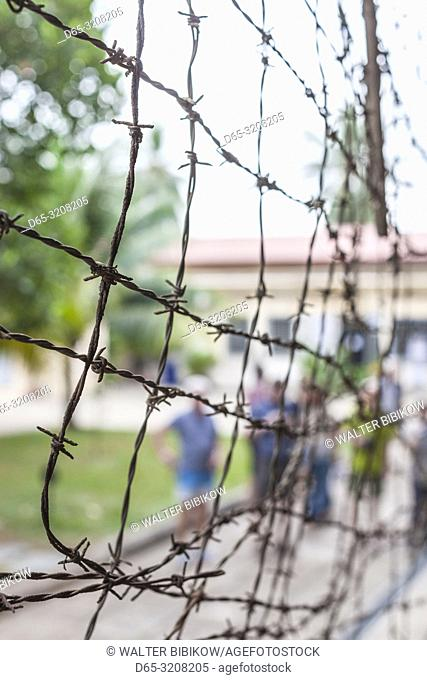 Cambodia, Phnom Penh, Tuol Sleng Museum of Genocidal Crime, Khmer Rouge prison formerly known as Prison S-21, located in old school, barbed wire