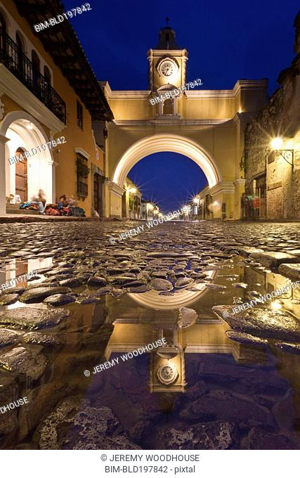 Cobblestone street and arch in quaint town
