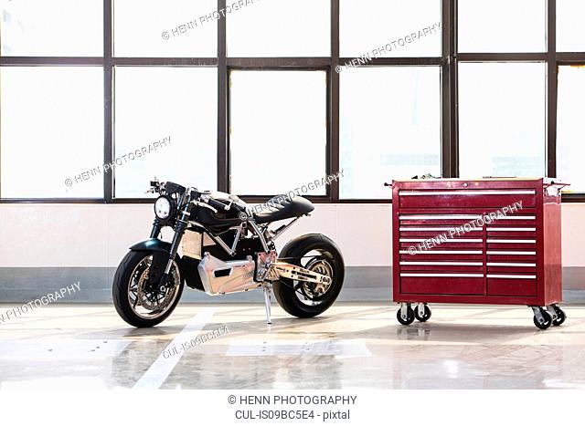 Electric cafe racer motorbike in garage