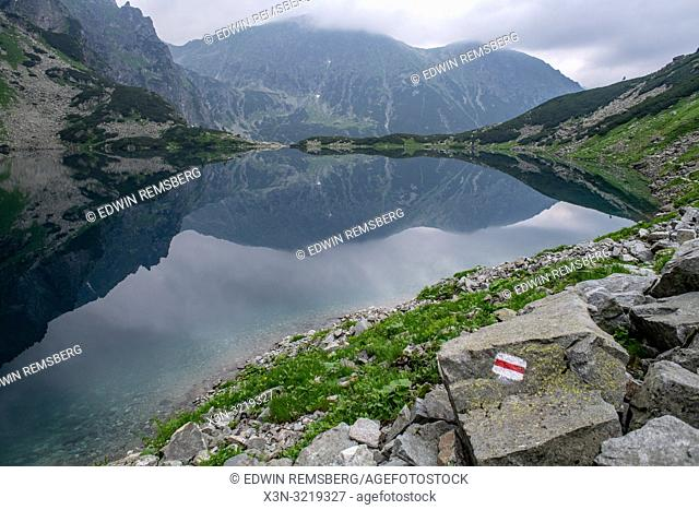 The Tatra Mountains Poland side of Mt. Rysy and Czarny Staw pod Rysami (Black Lake) in the Tatra National Park, Lesser Poland Vovoidship, Poland