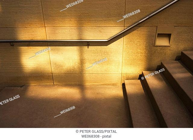 Concrete staircase with a handrail