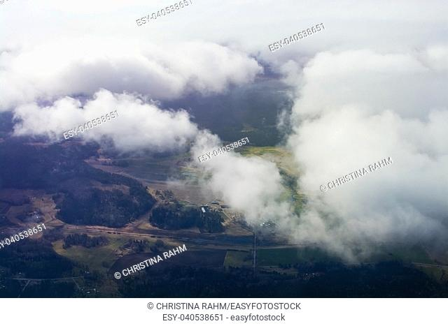 Flight images with clouds in interesting formations near Arlanda airport, Stockholm, Sweden