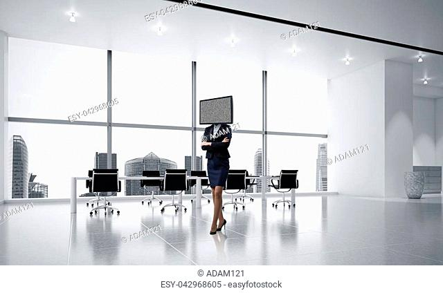 Business woman in suit with TV instead of head keeping arms crossed while standing inside office building. 3D rendering