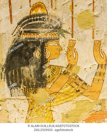 UNESCO World Heritage, Thebes in Egypt, Valley of the Nobles, tomb of Menna. A beautiful woman in adoration. With collar, bracelets, earings, lotus flower