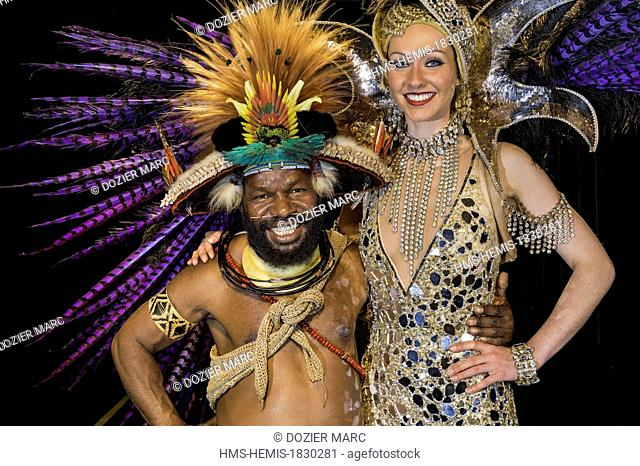 France, Paris, Champs Elysees, Lido, Papuan Mundeya Kepanga in stage with the Lido's dancer Zara Dean before the Bonheur show