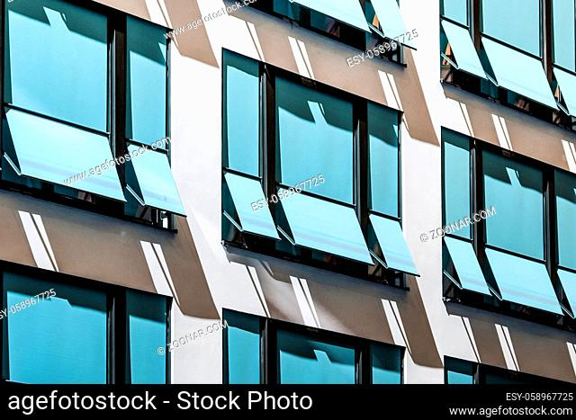 closed sun blinds on building facade , modern sunshades / awnings