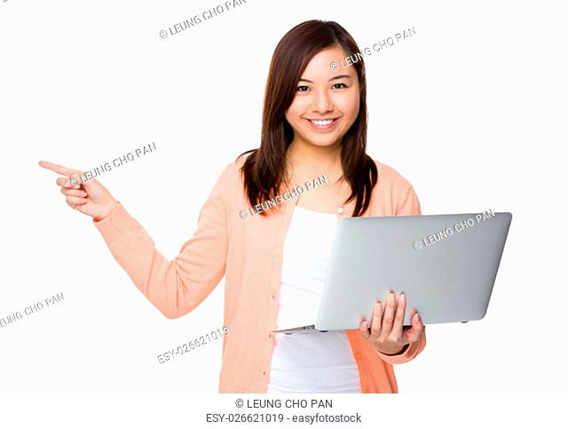 Asian Young Woman hold with laptop computer and finger point up