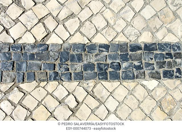 black and white stones forming a geometric figure in Lisboa
