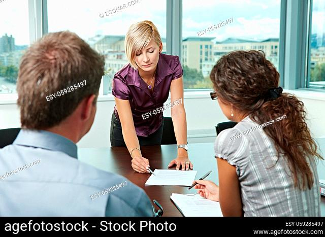 Team of casual looking business people having business meeting at office