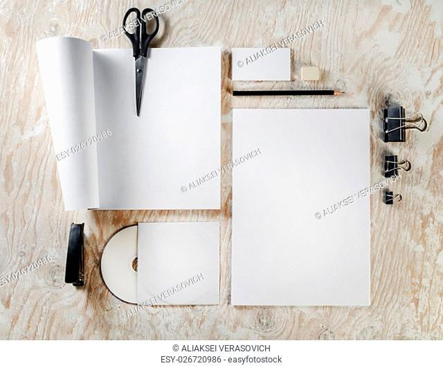 Photo of blank stationery and corporate identity template on light wooden background. Template for design presentations and portfolios