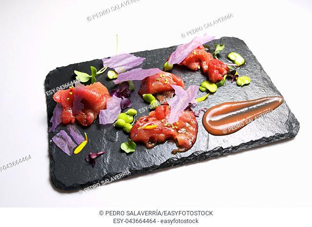 Red tuna sashimi on a slate plate