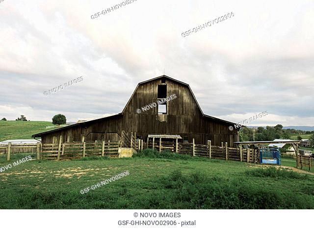 Rural Barn against Cloudy Sky