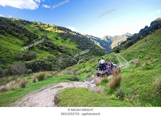 Travelers Explore The Grounds Of The Blue Duck Lodge On A Buggy Tour, Whanganui National Park; Whakahoro, New Zealand