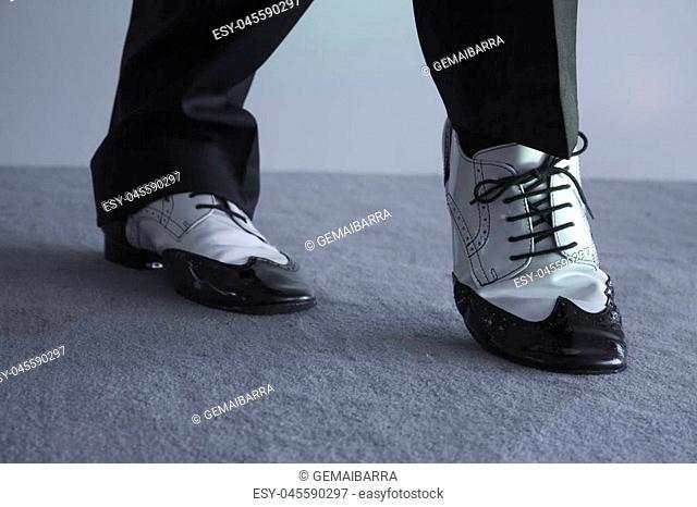 Dancing shoes feet of male ballroom, latin, salsa and swing dancer